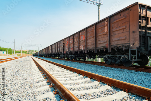 Train cars are on the rails