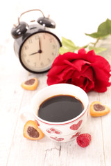 coffee cup,red rose and alarm