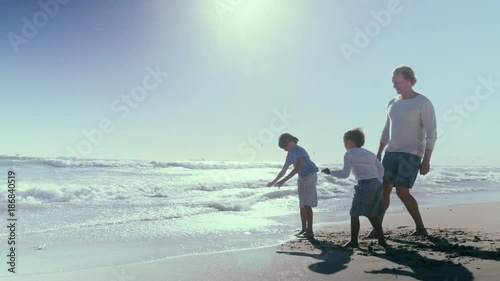 Father with sons on beach