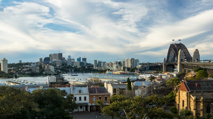 Sydney harbor panorama during the day with old buildings in the foreground and Milsons Point suburb in the background, Australia.
