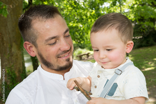 father and son kid in outdoor garden park