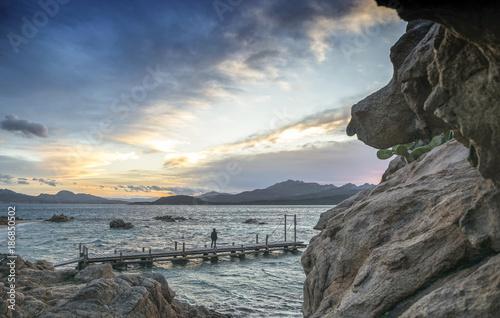 Foto op Canvas Grijze traf. Spiaggia del pirata al tramonto - Capriccioli (Costa Smeralda)