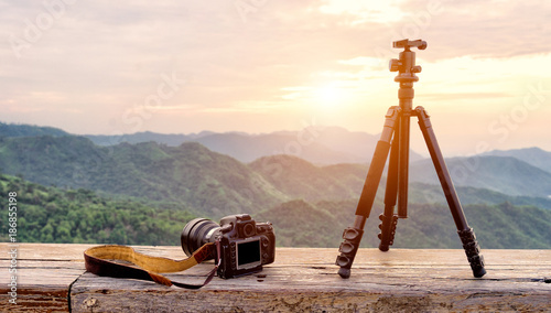 Foto Murales Travel photographer equipment with beautiful landscape on the background, Traveling and Relax Concept.