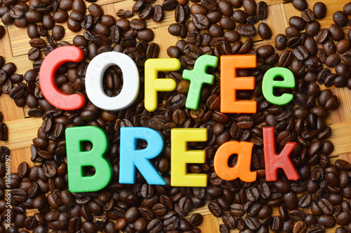 It's time for coffee break concept with colourful text on roasted coffee beans background