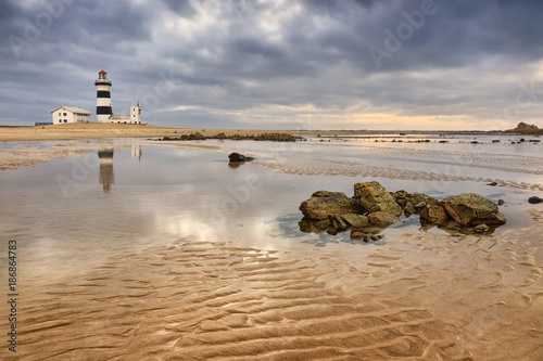 Tuinposter Ochtendgloren Lighthouse lansdcape with reflections in the water and moody sky, Cape Recife, Port Elizabeth, South Africa