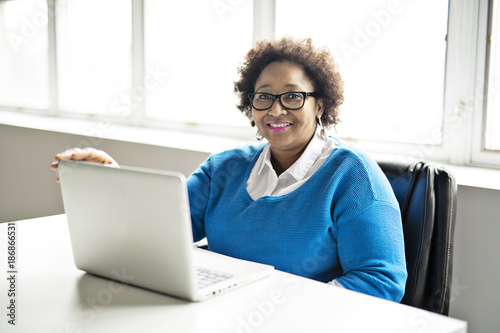 Sticker Portrait of cheerful business African-American working on laptop