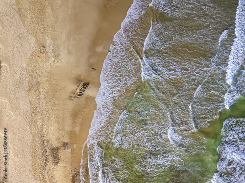 Foto op Canvas Natuur Seascape aerial view from above with water, waves and sand