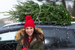 Young Woman Buying Christmas Tree