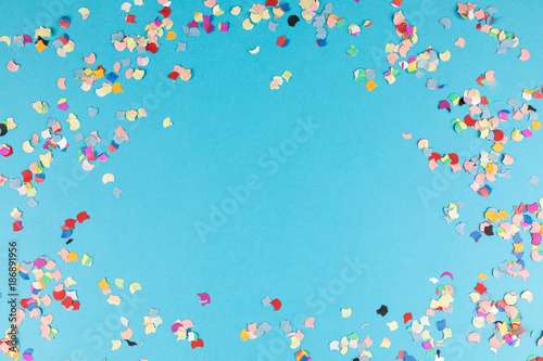 Foto Murales blue background frame with confetti