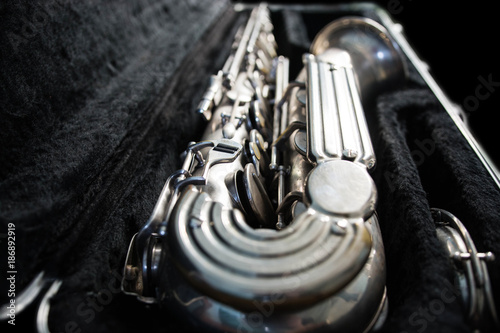 Silver saxophone in its case