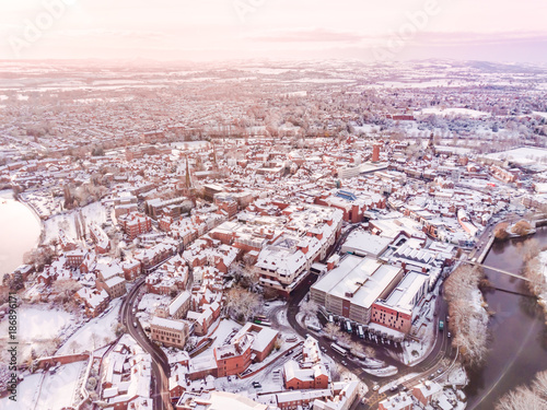 Aerial view of snowy historic English town, Shrewsbury. 1100 year old Market Town in England is covered in snow at Christmas