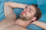 Guy with beard on unshaven face and sexy bare chest