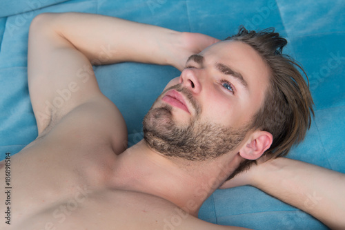 Guy with beard on unshaven face and sexy bare chest - 186898584