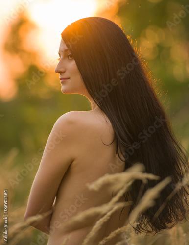 Fotobehang Kiev young nude girl in the rays of the setting sun