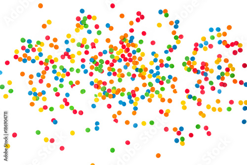 Sugar sprinkle dots hearts, decoration for cake and bakery, as a background. Isolated on white. - 186904711
