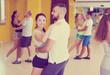 Smiling people dancing waltz