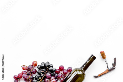 Open the wine. Corkscrew near bottle and grape on white background top view copyspace - 186906333