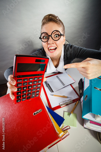Businesswoman with big red calculator. - 186928799