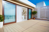 roof top patio with open space kitchen, sliding doors and decking on upper floor - 186929763