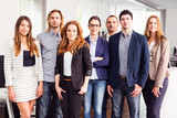 Small Business Team In Their Office - 186933598