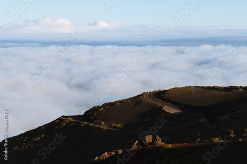 Deurstickers Canarische Eilanden Empty road above cloud inversion in desert landscape while sunrise