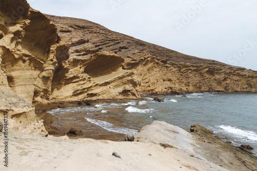 Deurstickers Canarische Eilanden Remote sand beach in volcanic landscape in summer