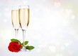 Two champagne glasses and rose