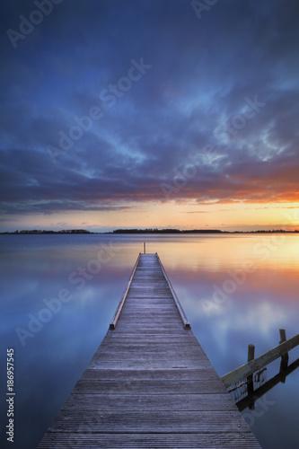 Acrylglas Pier Jetty on a lake at sunrise, near Amsterdam The Netherlands
