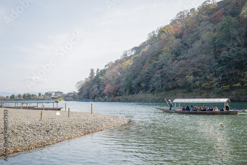 Fotobehang Kyoto Boat on river arashiyama japan, autumn red tree