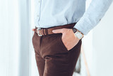 cropped image of businessman with hands in pockets - 186962968