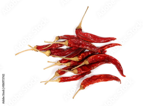 Foto op Canvas Hot chili peppers Dry red hot chili peppers, pile isolated on white background, top view