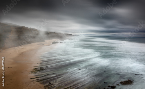 Storm and fog at the beach