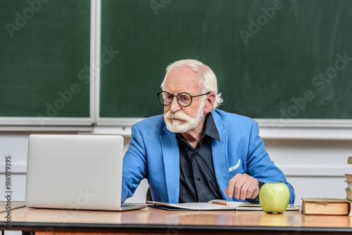 Senior confident man at school  - 186979395