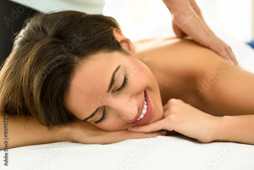 Foto op Aluminium Kasteel Young woman receiving a back massage in a spa center.