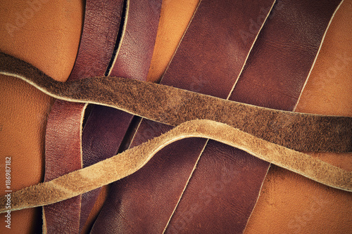 cut brown leather straps