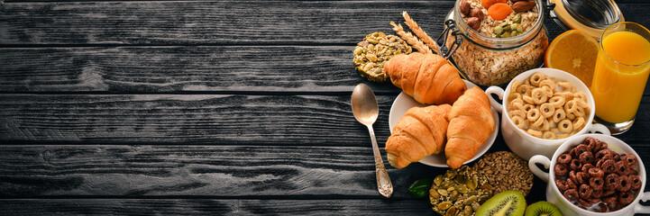 Breakfast served with coffee, orange juice, croissants, cereals and fruits. Balanced diet. © Yaruniv-Studio