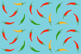 seamless pattern of red  green and yellow chili pepper in flat icon design on blue color background