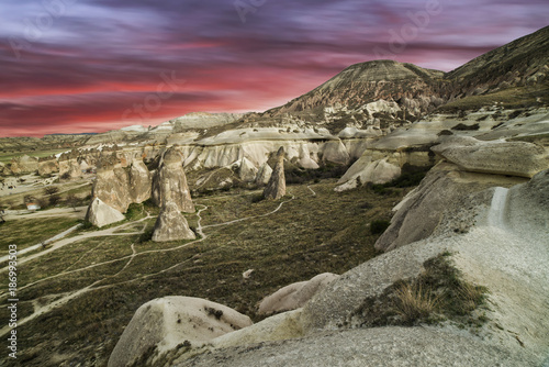 Foto op Canvas Lavendel sunset of fire on the stone ruins of a city in Cappadocia