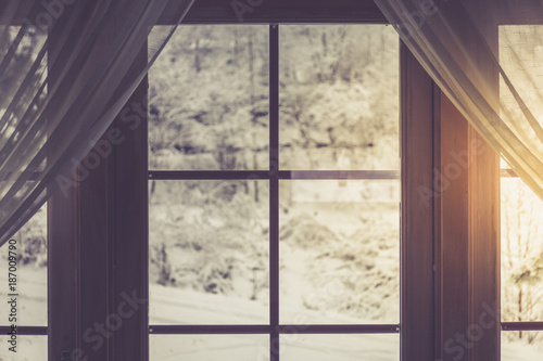 Foto Murales Window and snowy nature