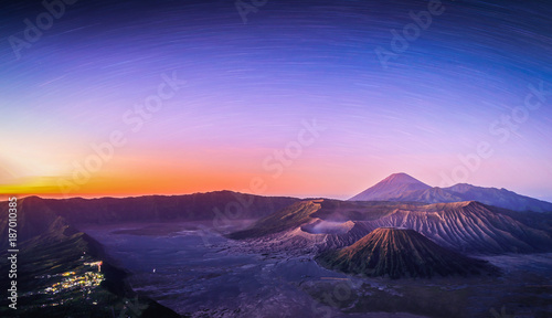 Mount Bromo volcano (Gunung Bromo) at sunrise with star trail in Bromo Tengger Semeru National Park, East Java, Indonesia.