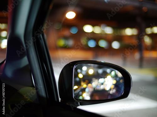 Foto op Plexiglas Motorsport car side mirror with bokeh