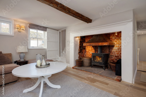 Foto Murales Cottage living room with fireplace and stove