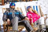 Smiling couple on break from skiing enjoy on sun - 187020501