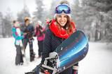 Female snowboarder hold snowboard - 187021933