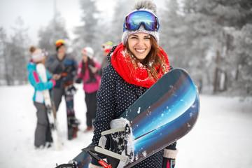 Female snowboarder hold snowboard
