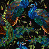 Embroidery peacocks tropical birds and flowers seamless pattern. Classical fashionable embroidery beautiful peacocks. Fashionable template for design of clothes. Tails of peacocks art. - 187022314