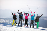 Back view of skiers in mountain
