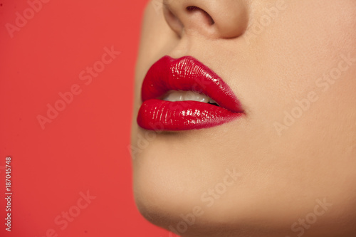 Foto Murales woman's lips with red lipstick