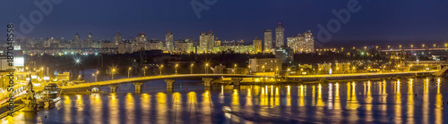 Fotobehang Kiev Kyiv (Kiev) city, the capital of Ukraine at night beside the Dnipro (Dniepr) river with reflection in water
