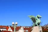 Dragon sculpture and street lamp on The Dragon Bridge - historical landmark in Ljubljana, Slovenia.